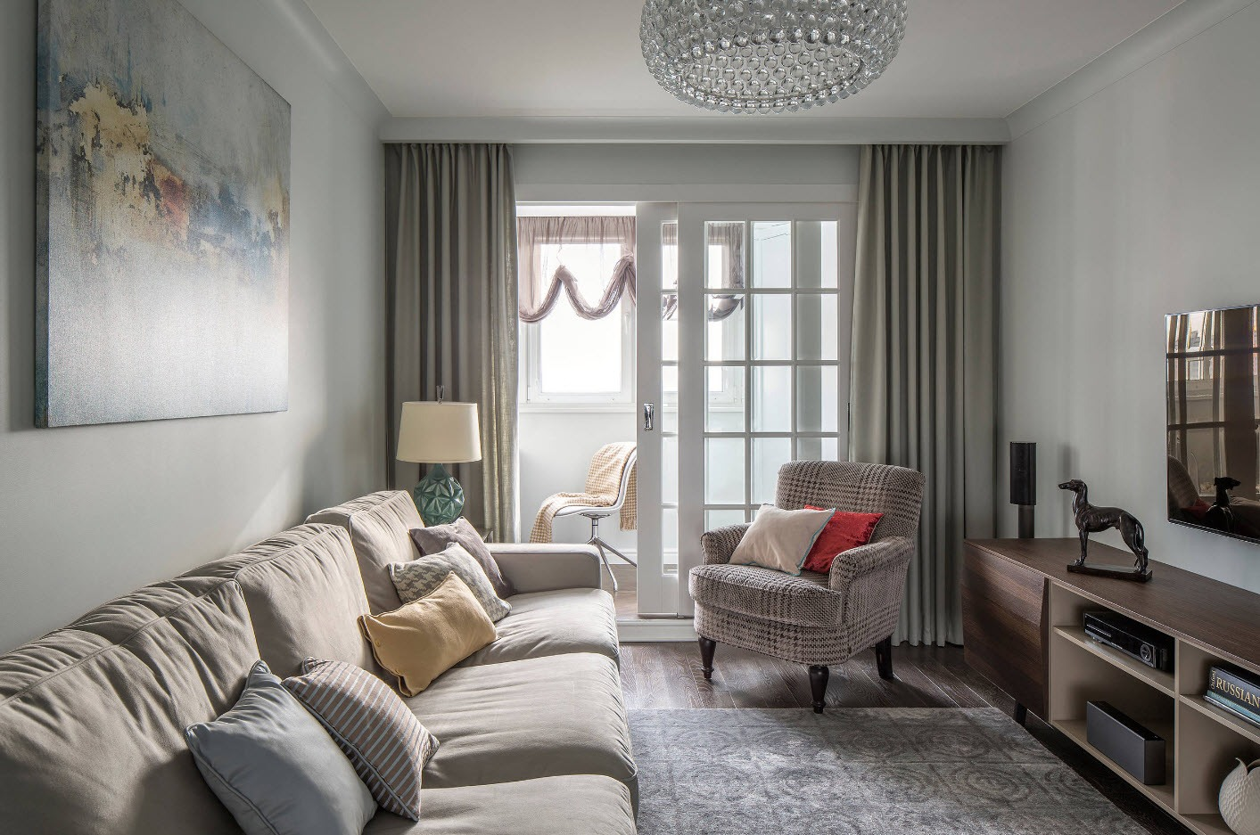 Casual styled living room with the balcony behind gray curtains