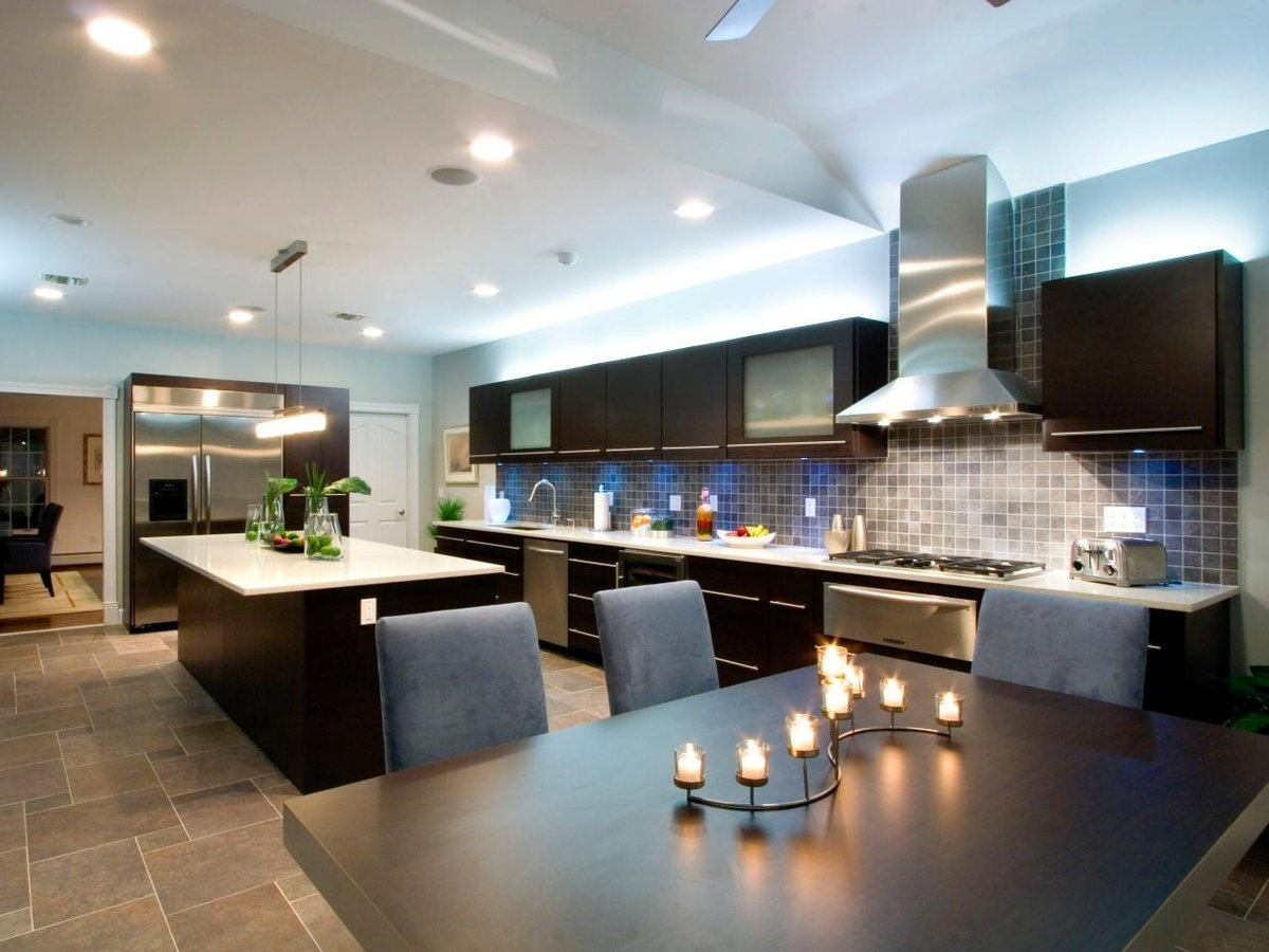 Typical modern designed kitchen with abundance of artificial light and functional zones