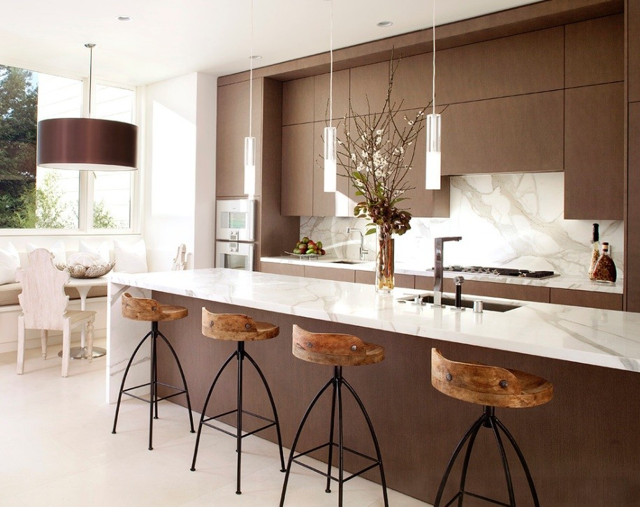 Brown and white color combination along with chairs at the modern styled island