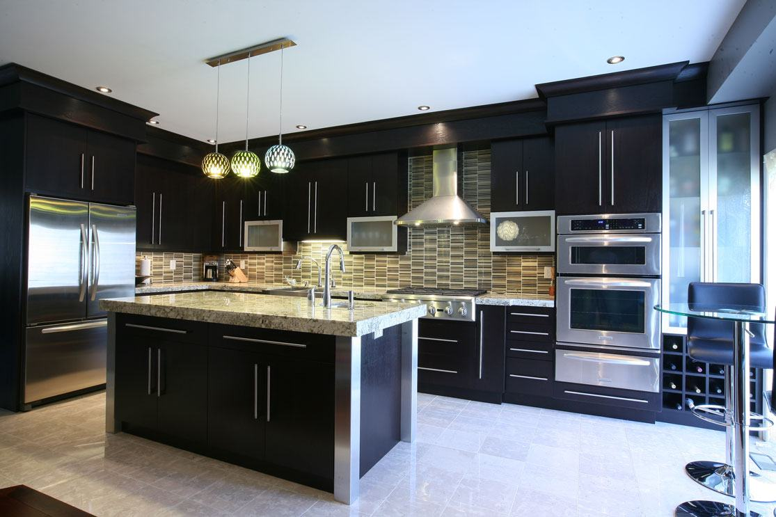 Black designed kitchen furniture and white floor