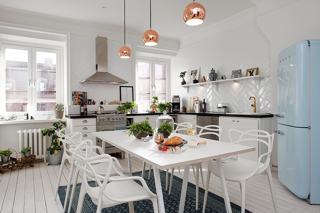 Scandinavian Style Kitchen: Interior Decoration and Furniture Ideas. Bronze lamps over the dining zone