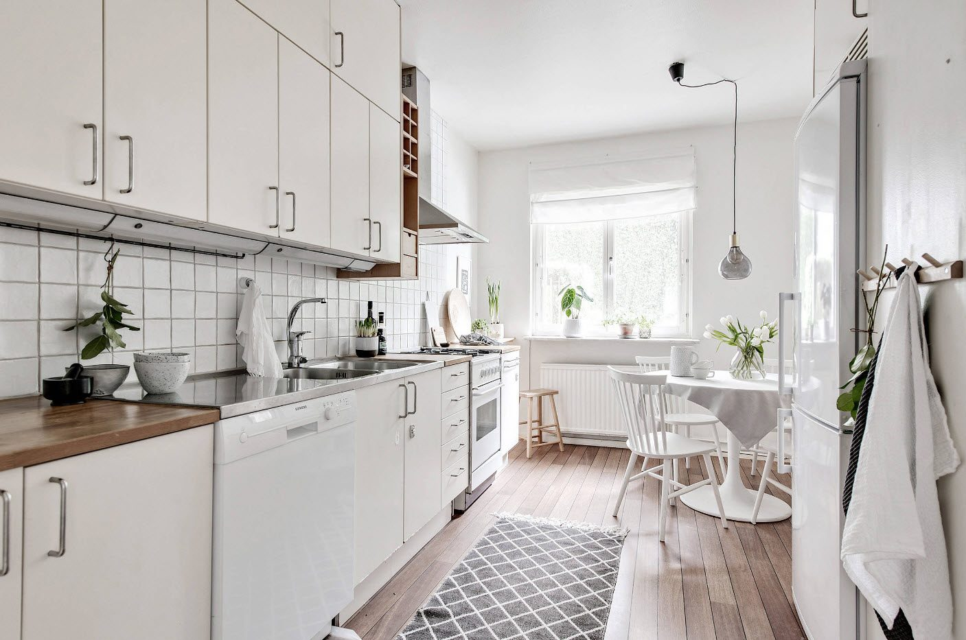 Classic Scandinavian style with wooden floor, dark carpet and simple designed furniture set
