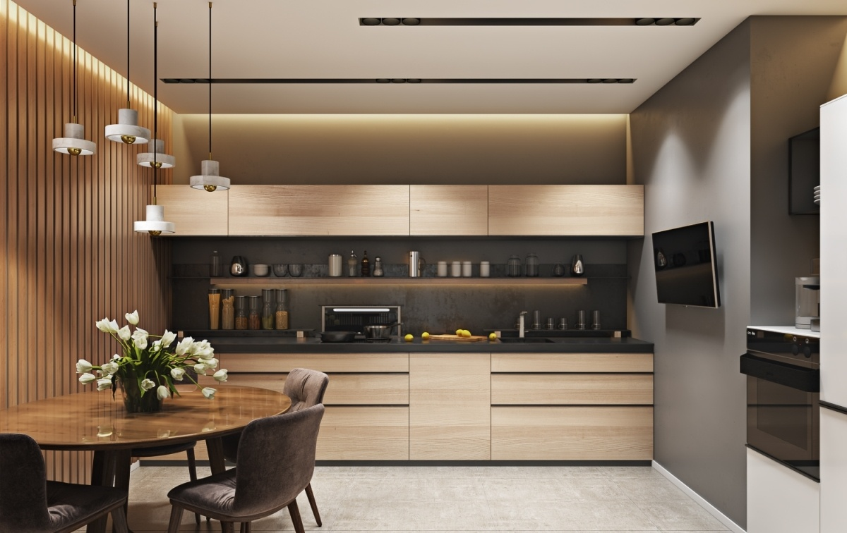 Light wooden kitchen facades and round wooden dining table