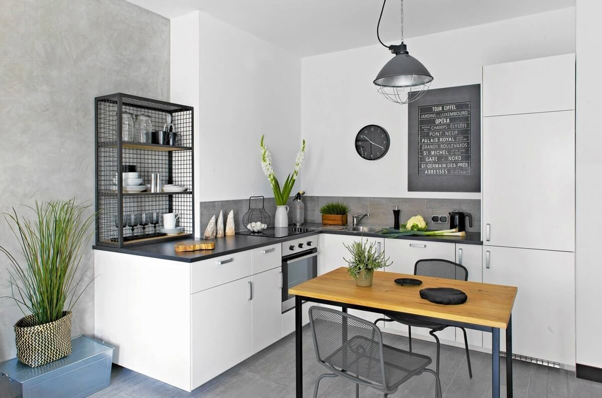 Scandinavian Style Kitchen: Interior Decoration and Furniture Ideas. Light wooden table and large working surface of the white smooth kitchen