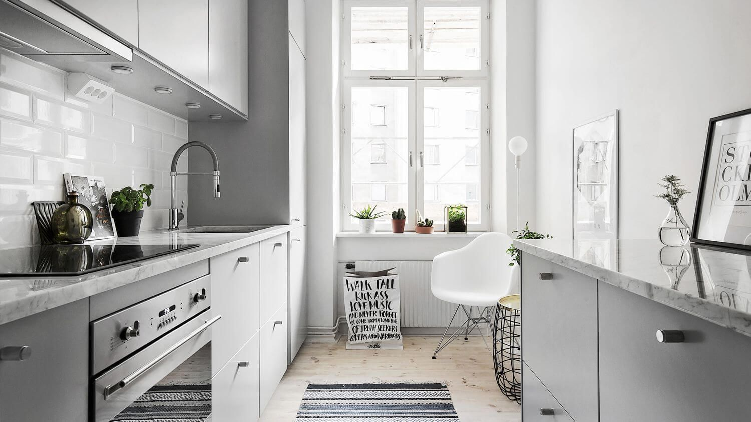 Galley small kitchen in gray and white tones with simple design and modern materials