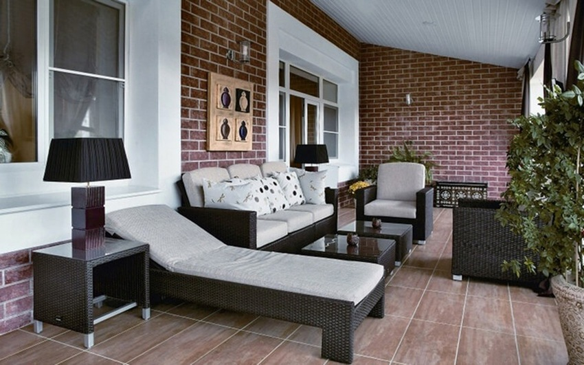 Large Balcony Design Ideas: Modern Trends in Furniture and Decoration. Artificial Rattan sunbeds right at the balcony with red brickwork
