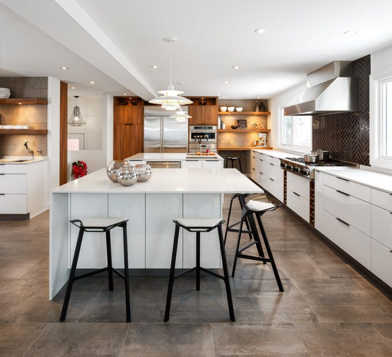 Large kitchen with dining group in modern Scandi style