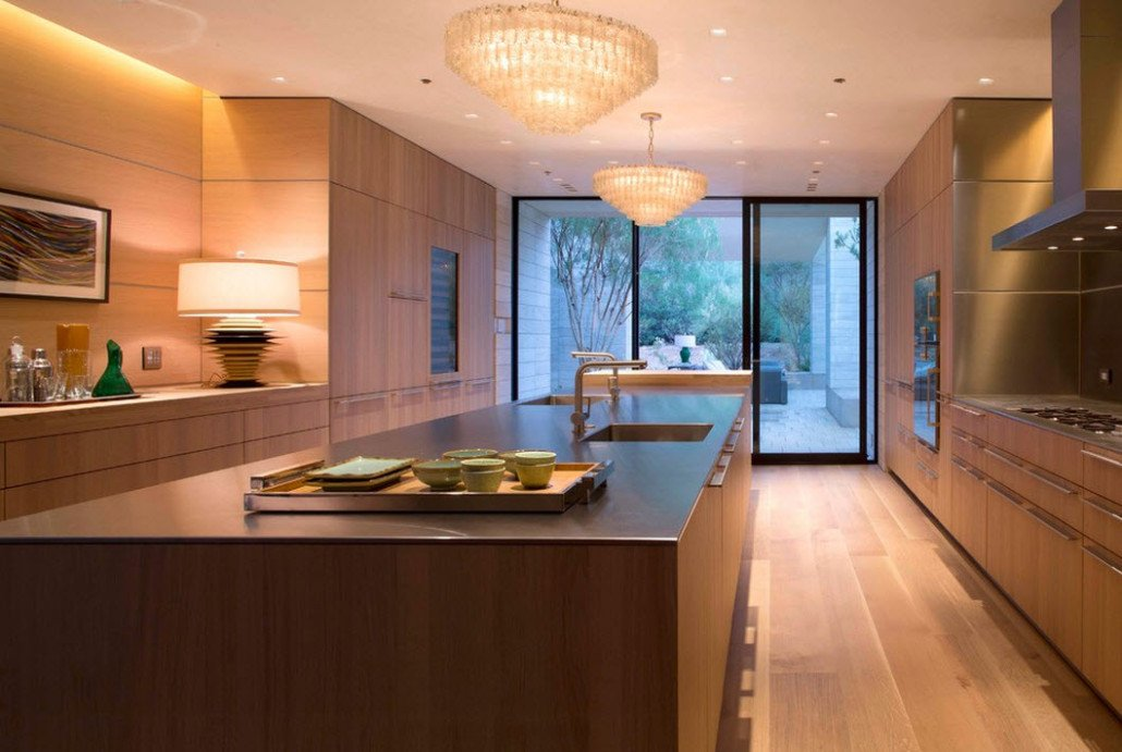 Kitchen at the entrance hall of the cottage in modern style with wooden finishing
