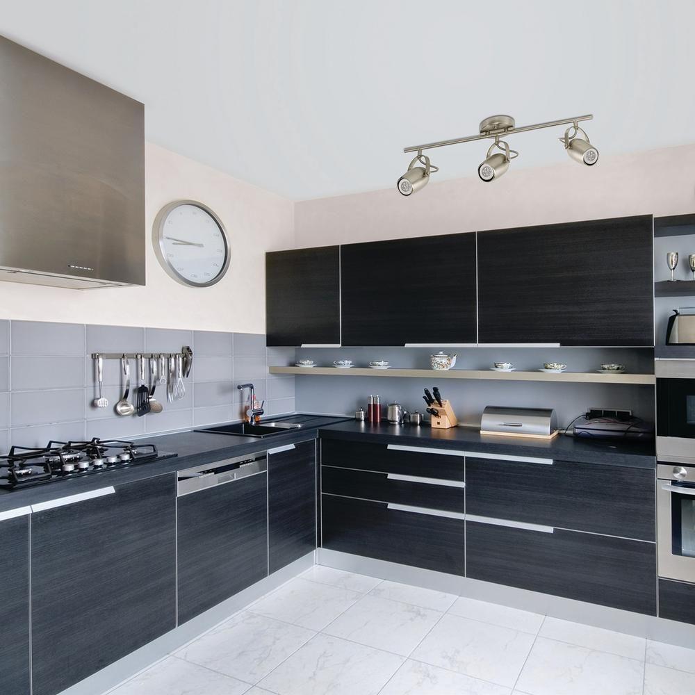 Black designed kitchen furniture and white tiled floor