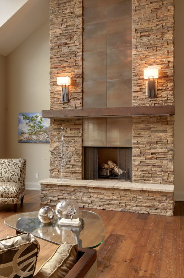 Chalet styled living room with the artificial stone trimmed fireplace