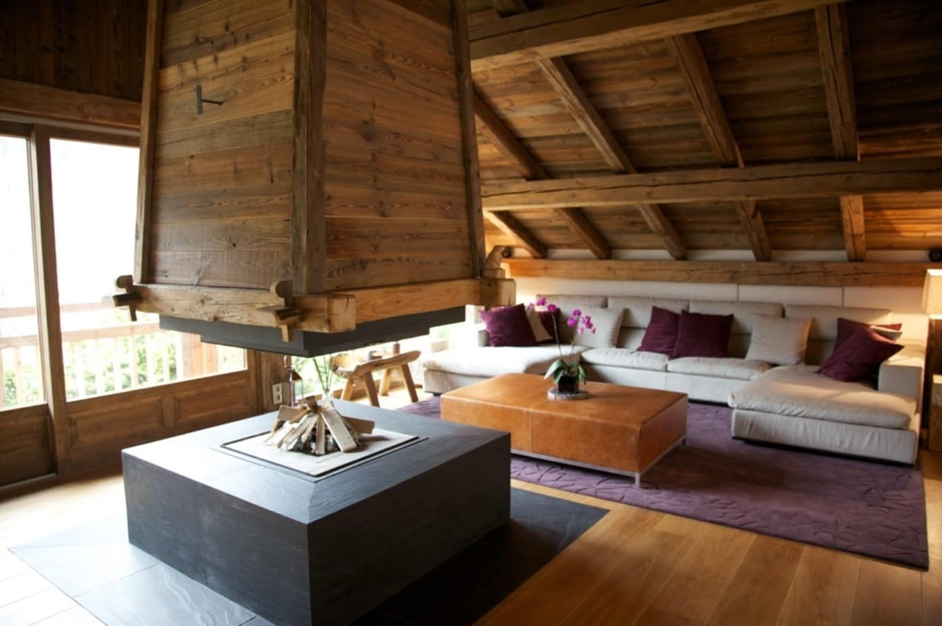 Unusual wooden decorated interior with central open fireplace