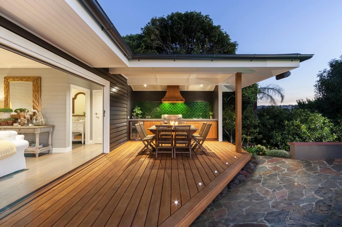 5 Unique Deck Ideas to Make the Most of Your Small Yard. Modern refined design of the backyard deck with built-in lighting and dining zone