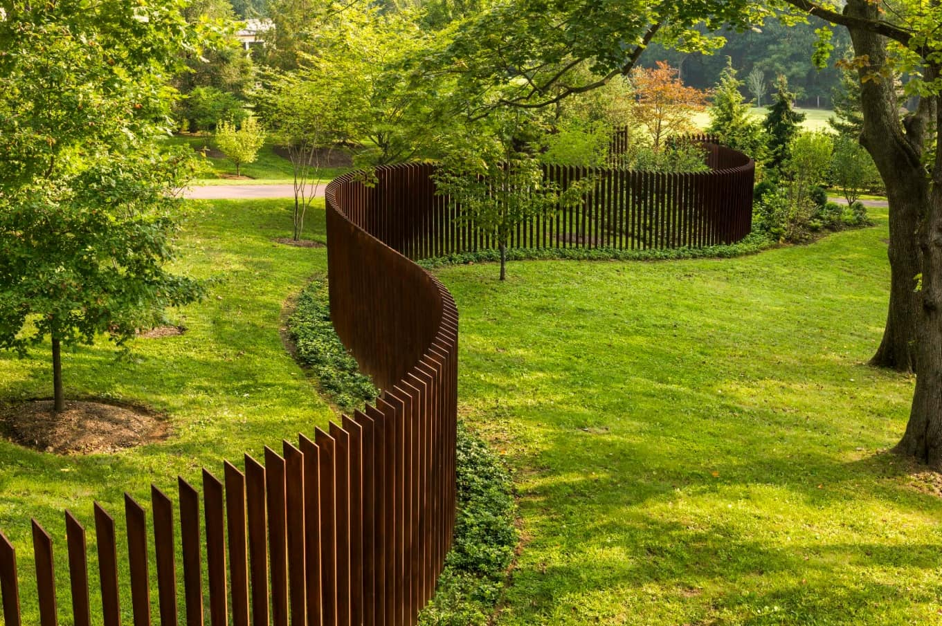 How to Choose the Appropriate Fence For Your Yard? Unusual wooden picket with sideway location of the logs