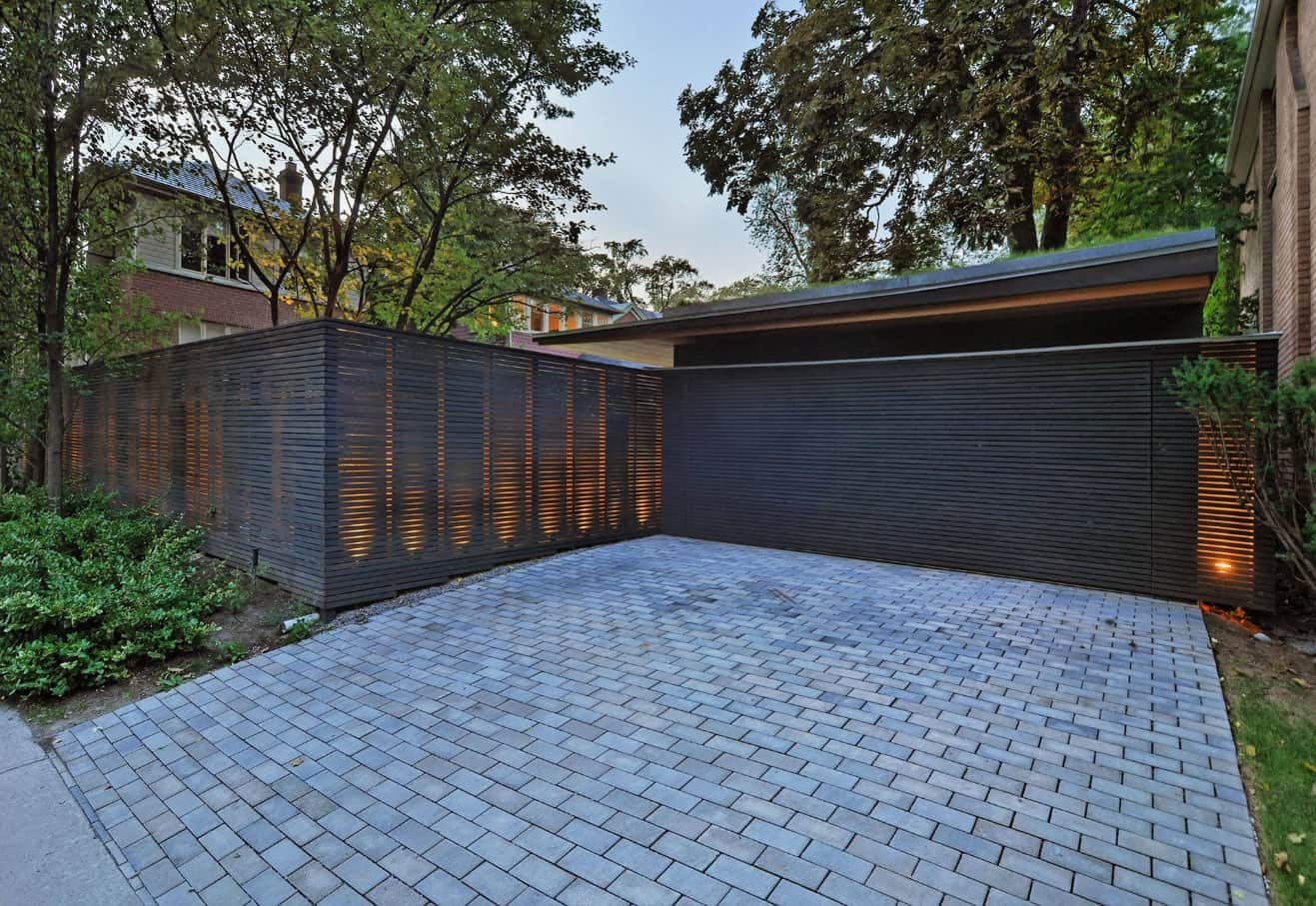 How to Choose the Appropriate Fence For Your Yard? Unusual woden fence design passing light
