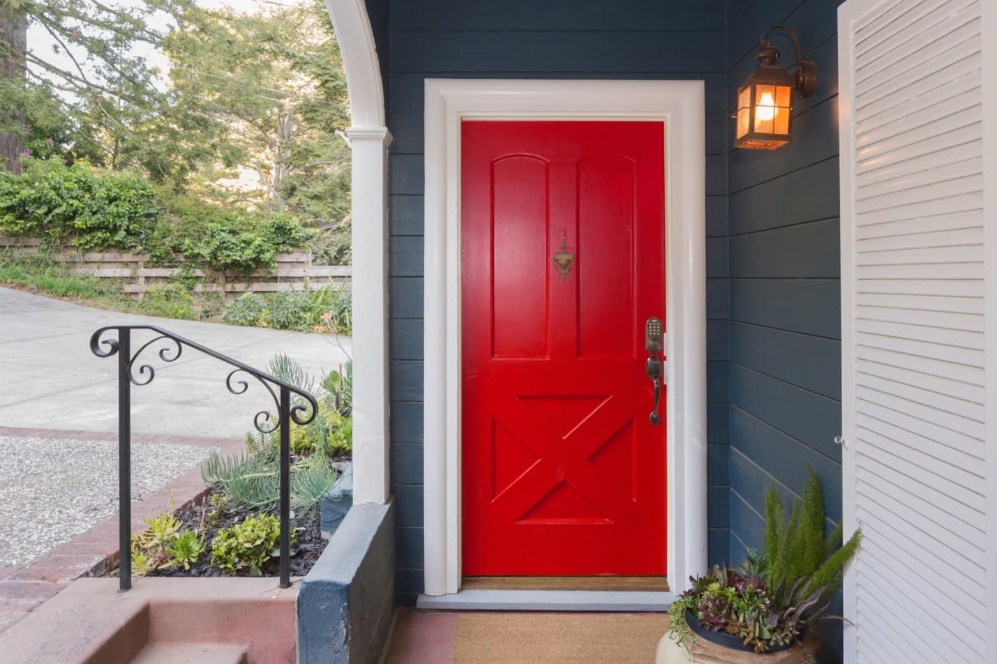 When One Door Closes: What Are the Benefits of Fiberglass Doors? Bright red entrance