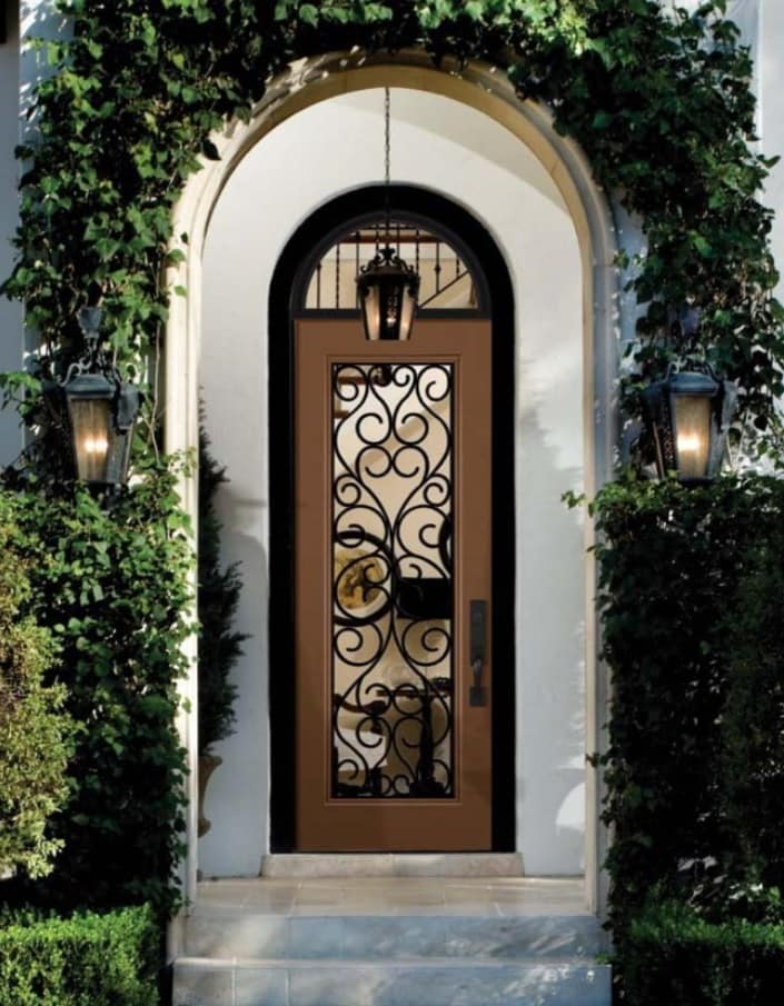 When One Door Closes: What Are the Benefits of Fiberglass Doors? The door of the classic house with forged inlay