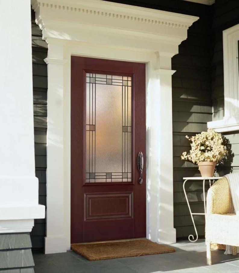 When One Door Closes: What Are the Benefits of Fiberglass Doors? Classic facade and dark red colored door