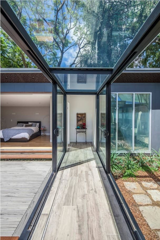 Sliding Glass Doors and Glass Wall Panels in Modern Commercial Interiors. Geat idea of the dedicated pathway between the zones of modern cottage