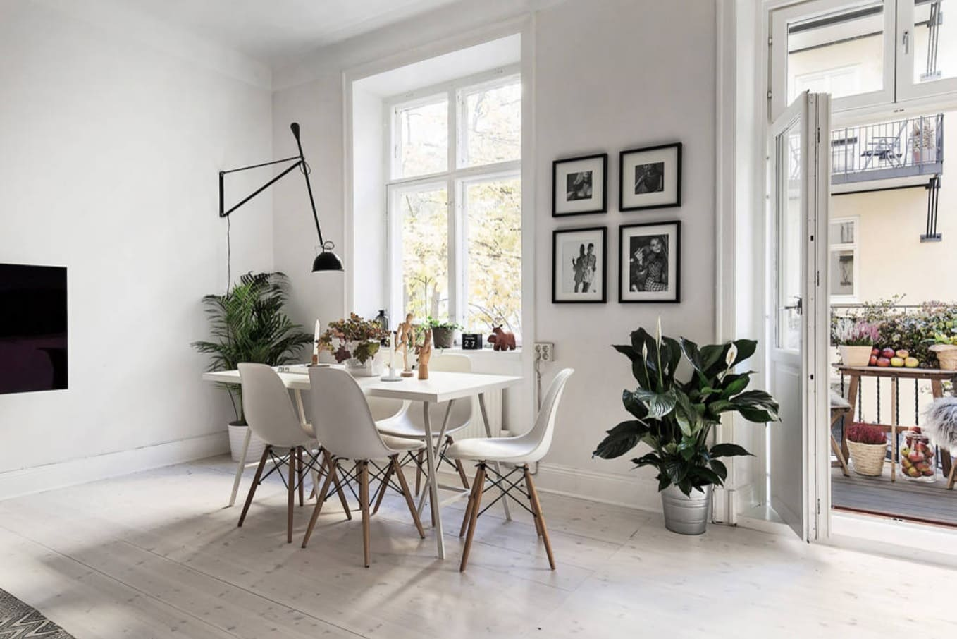 Overview of 10+ Biggest Home Design Trends in 2019 so Far. White designed dining room with black overhang lamp and plant decoration