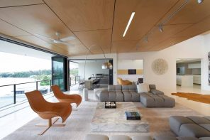 12 Ways You Could Make Your Home More Eco Friendly. Unusual designed modern living room with paneled ceiling, modular sofa, relaxing chairs and marble imitating stand as the coffee table