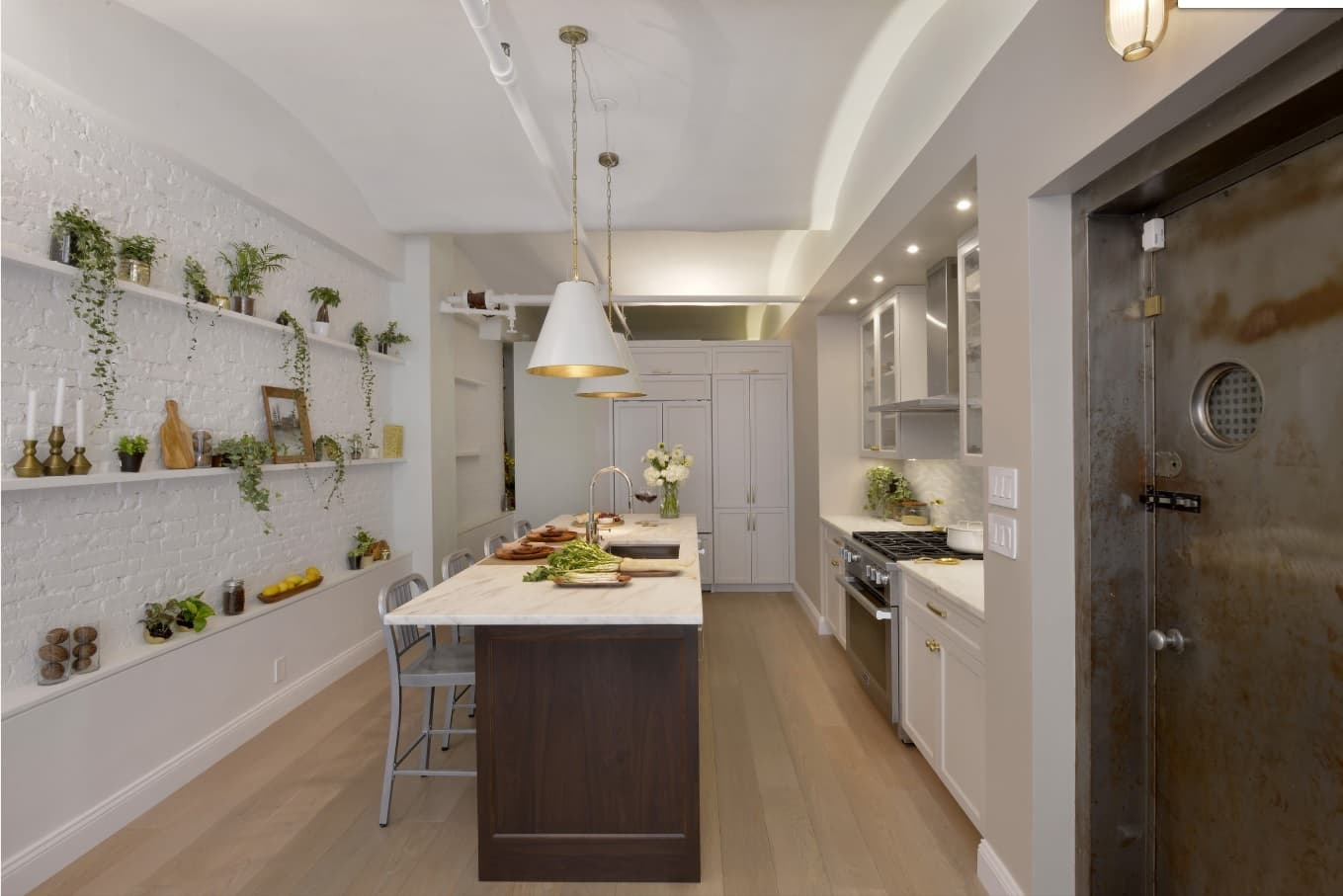 12 Ways You Could Make Your Home More Eco Friendly. Dark sided kitchen island and Classic white interior with plants on shelving