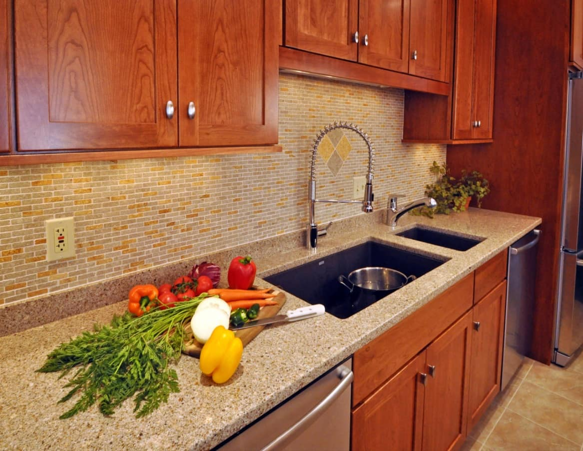 How to Redesign Your Kitchen This Summer. Natural wooden facades for the Classic styled kitchen with two sinks in the ceramic countertop