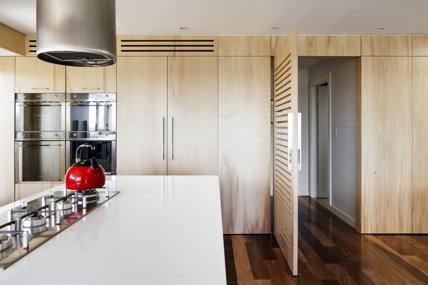 How to Redesign Your Kitchen This Summer. All-wooden decoration at the contemporary styled kitchen with dark glossy laminate and large countertop
