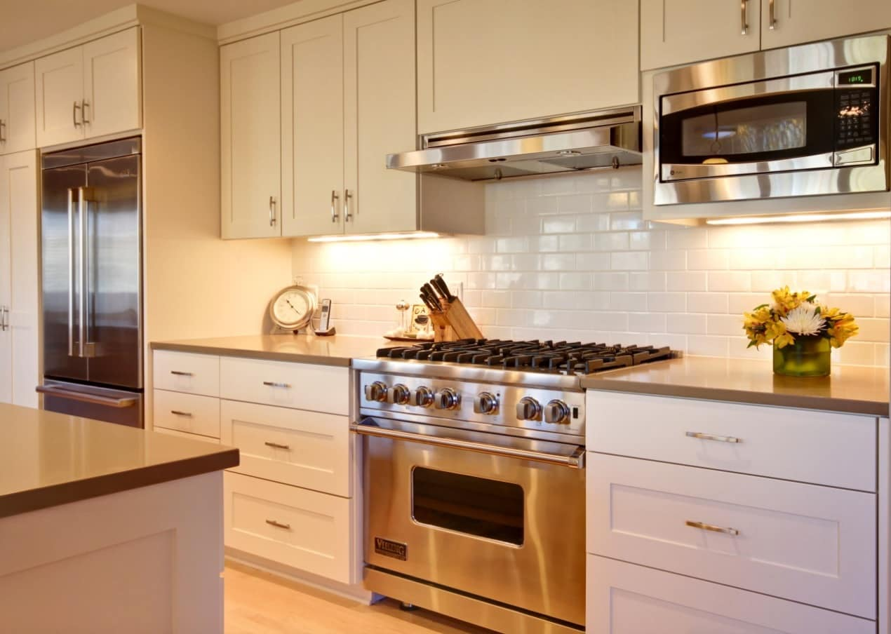 How to Redesign Your Kitchen This Summer. Microwave and the classic hob at the white designed kitchen