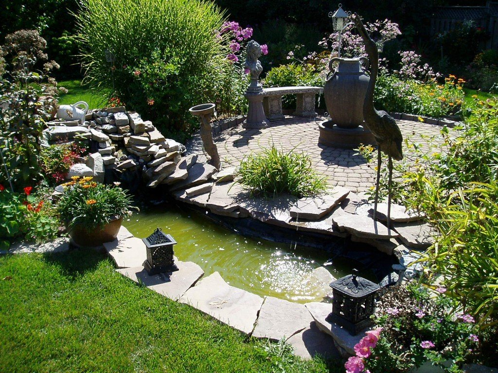 Decorative pond and the bridge over it in natural stone