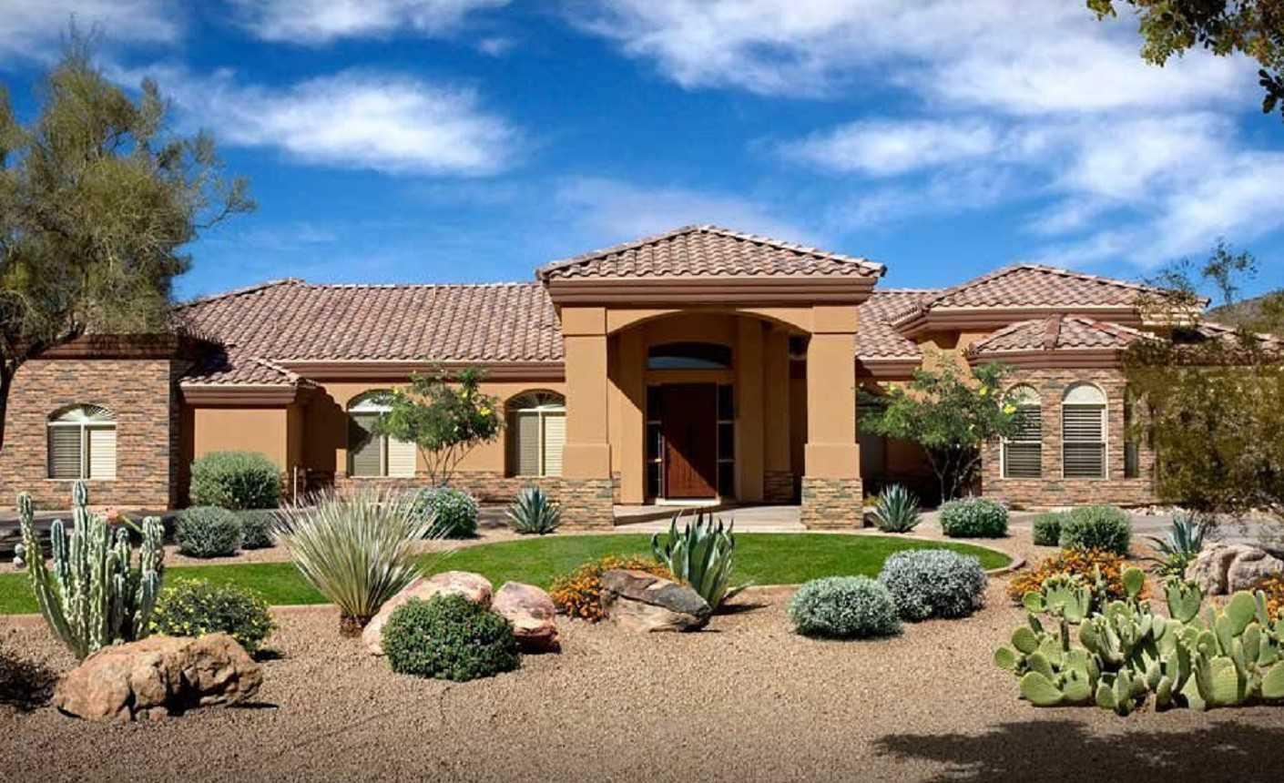 Summer cottage with desert landscape design