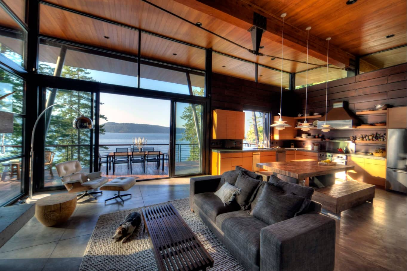 How to Turn Your Home Into a Dream Log Cabin. Modern designed cottage with open space in wood and black color