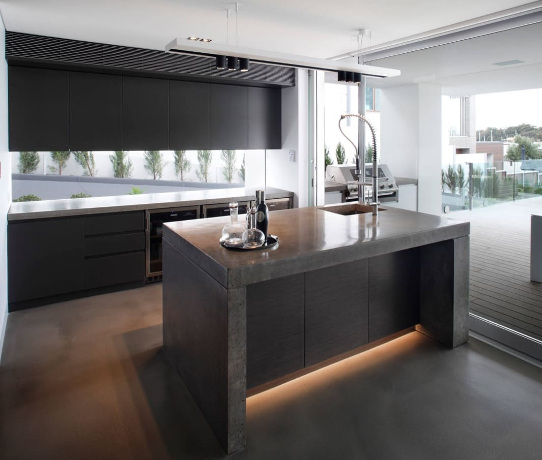 The Interior Design Guide For Styling a Gentleman's Elegant Man Cave. Modern minimalistic and technological kitchen in dark tones