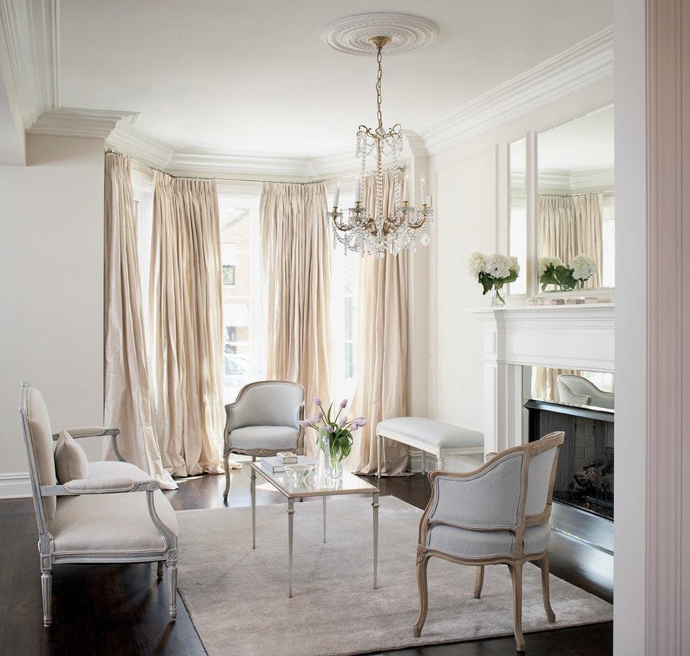 Bay window with creamy blackout curtains and classic furniture for the living room