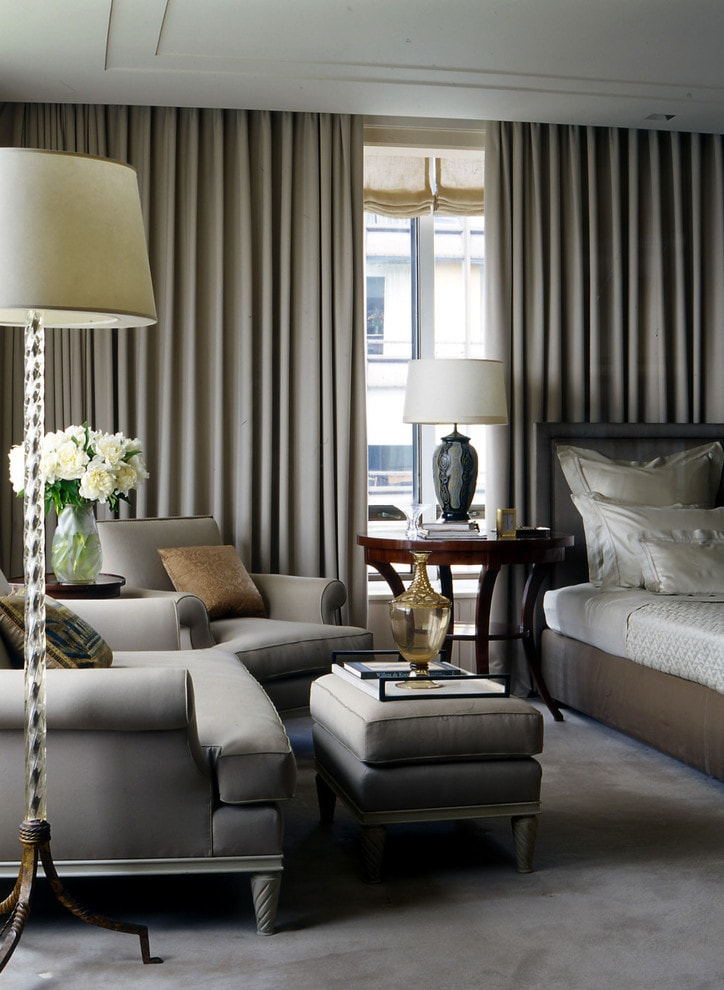 gray idyll in the living room with vintage standing lamps and thick drapes