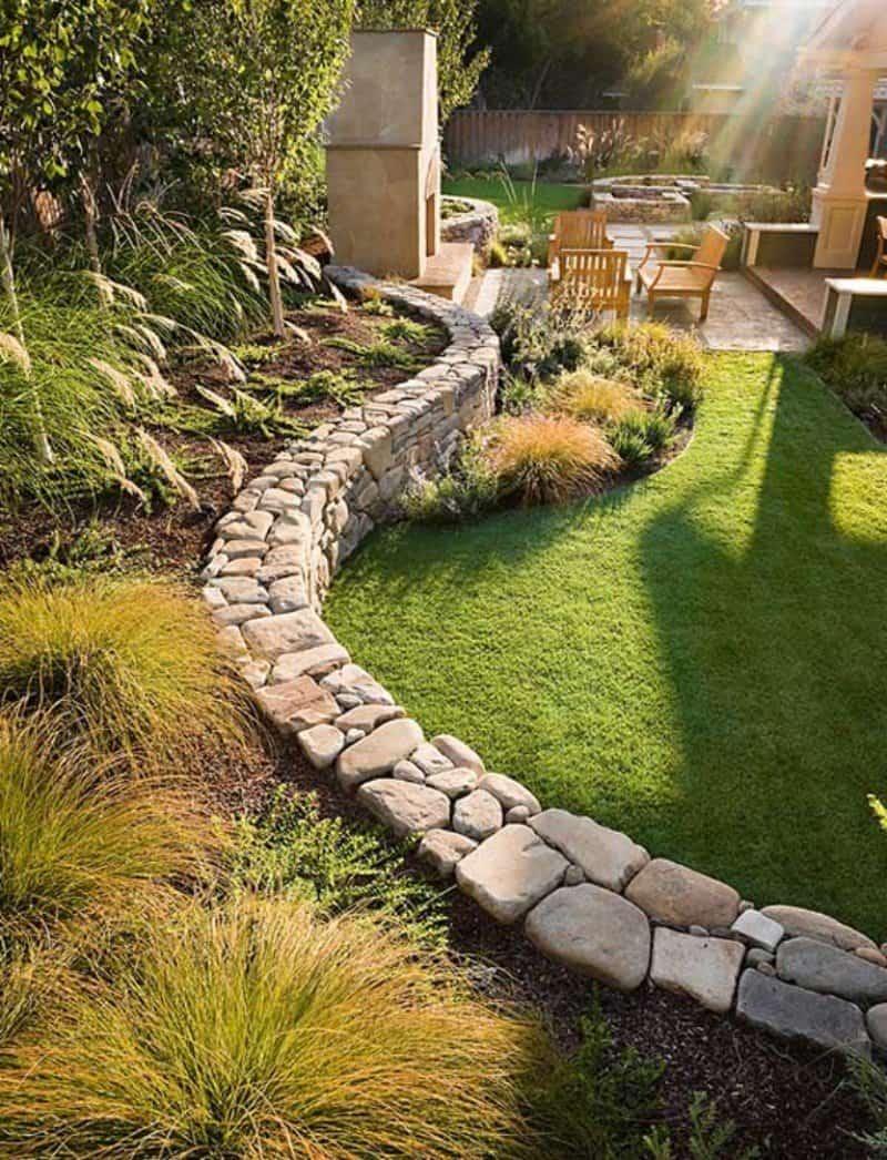 Granite laid hedge between the levels of the slope landscape design