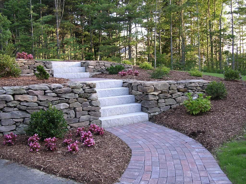 Granite slabs and concrete steps at the private house backyard