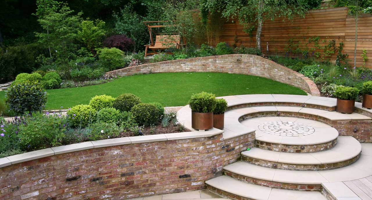Brick cladded pathways and bonsai trees at the plot