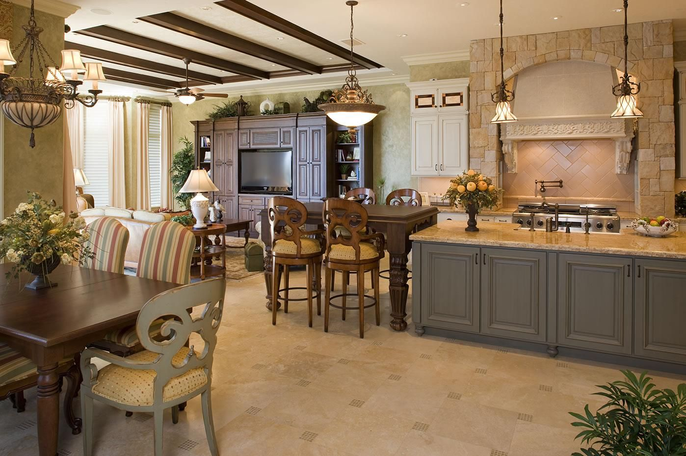 Mediterranean Style Kitchen Interior Design Ideas with Photos. Black wooden ceiling beams and warm sandy tones of decoration