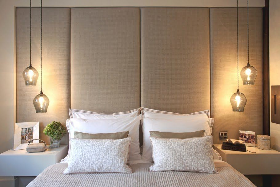 Soft headboard panels and simple pendant lamps at both sides