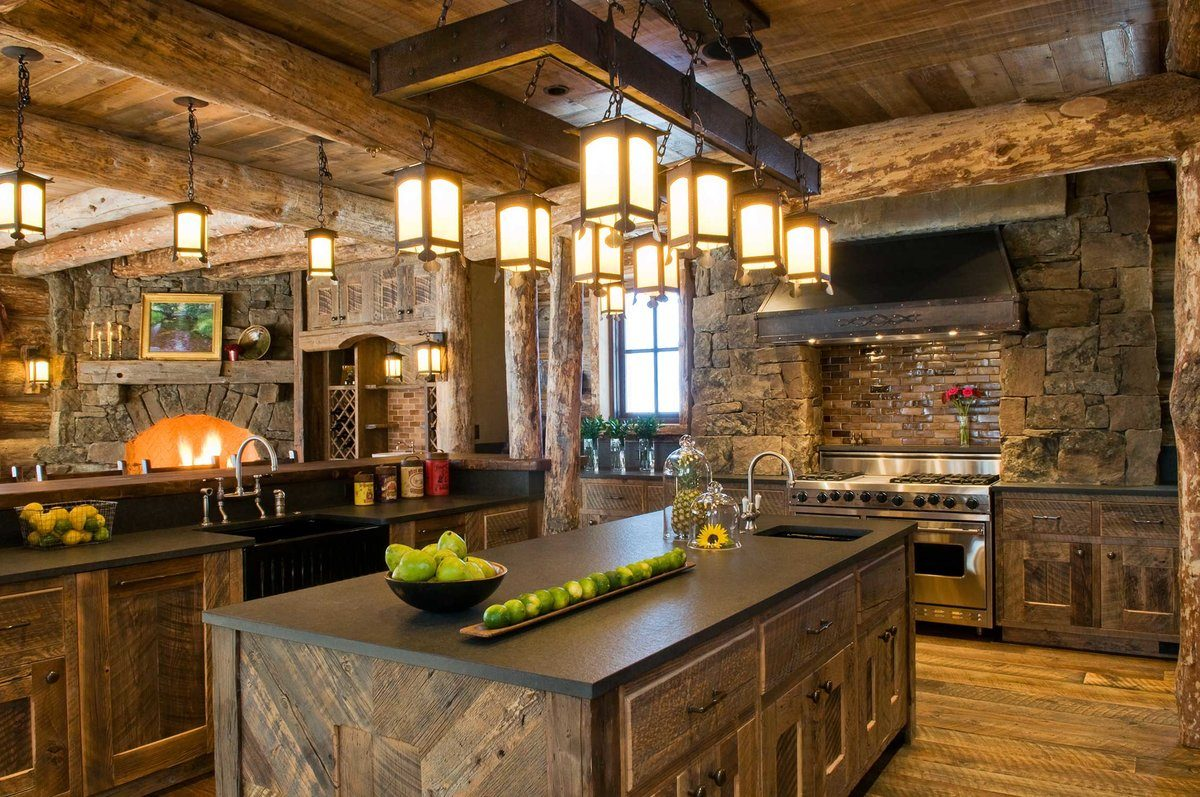 Chalet Kitchen Interior: Description, Design Tips with Photos. Kitchen island with large medieval chandelier and green apples