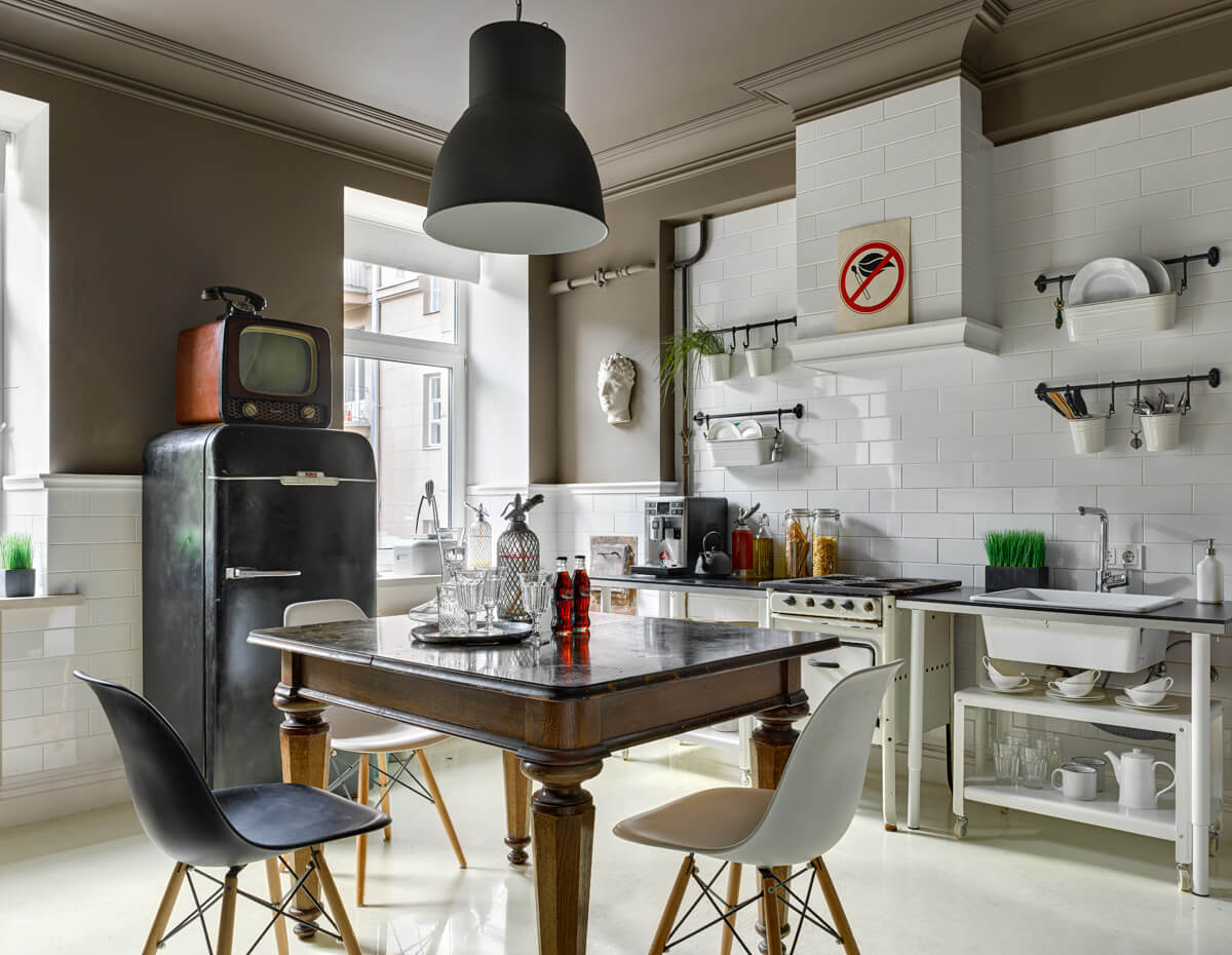 Fusion Style Kitchen Interior Design: Features and Arrangement Ideas. Classic wooden carved table with Scandinavian styled chairs at small casual space