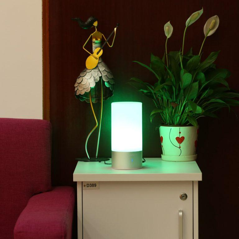 Green LED night lamp at the bedside table