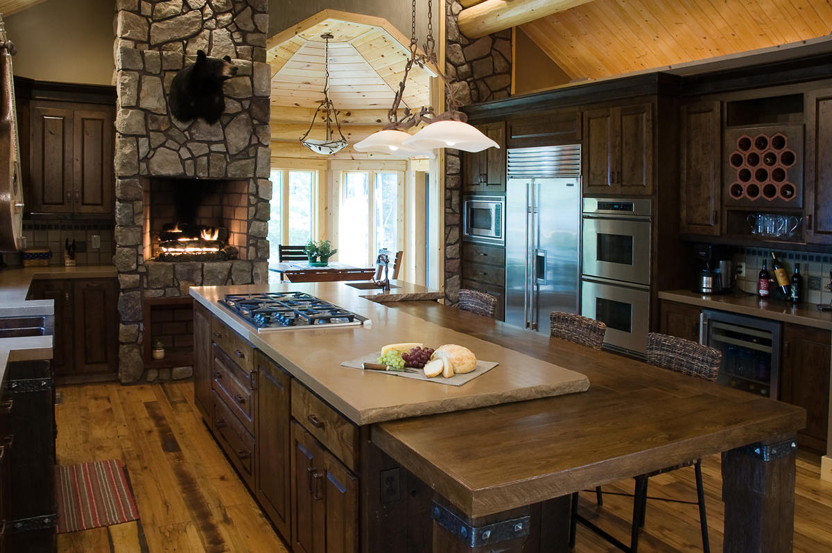 Chalet Kitchen Interior: Description, Design Tips with Photos. Stone trimmed oven, large central island with butcher block and cooking zone