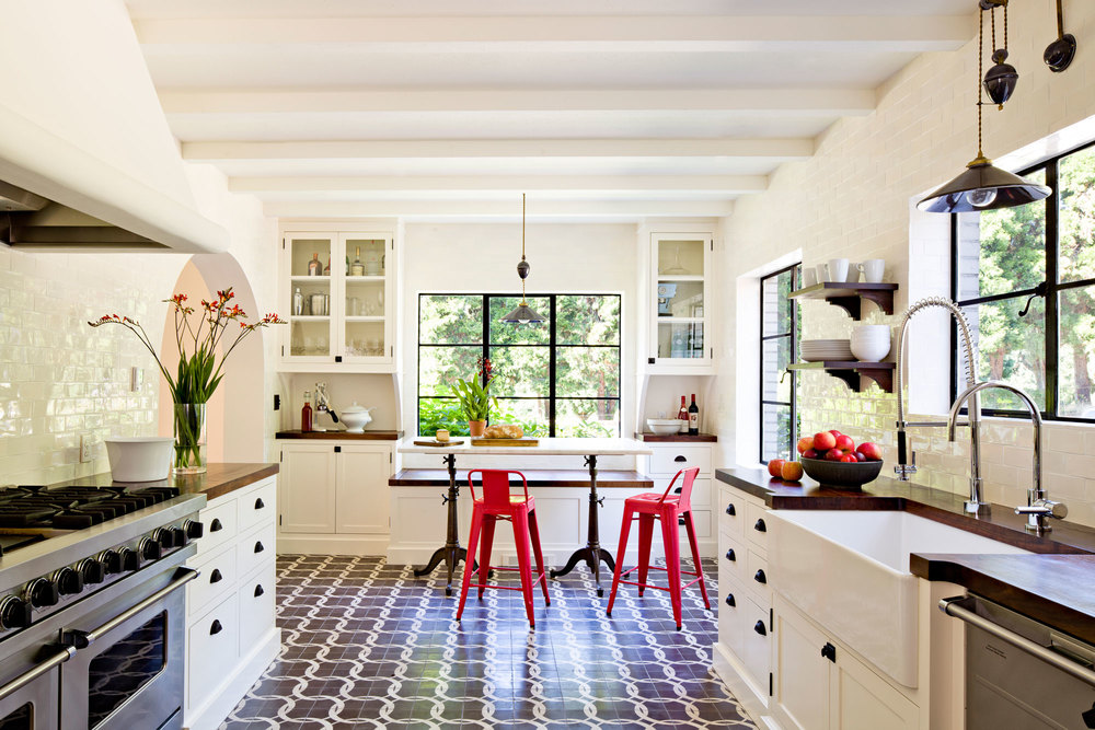 Mediterranean Style Kitchen Interior Design Ideas with Photos. Unexpected decor in contrasting kitchen with red chairs