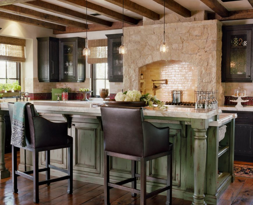 Stone trimmed oven and olive facade of the kitchen island