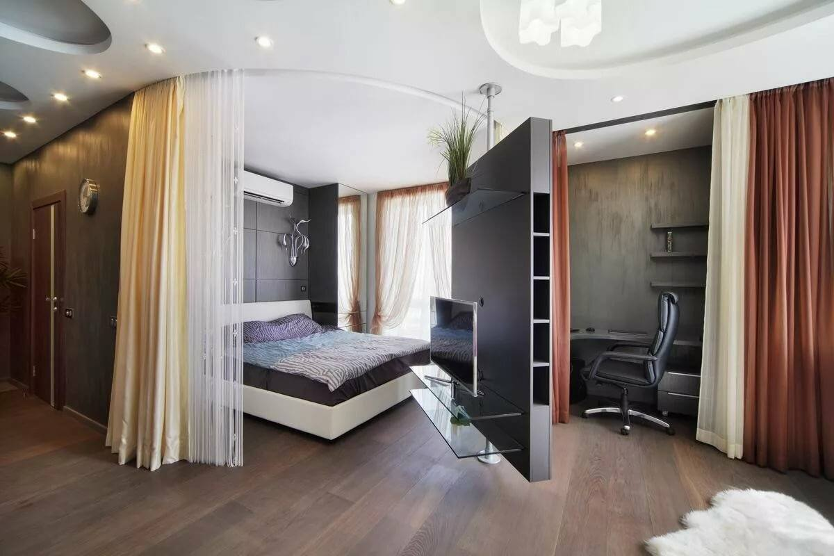 Studio Apartment Bedroom: Design Ideas and Pro Designers' Advice. Mechanic swivel multifunctional wall partition with TV
