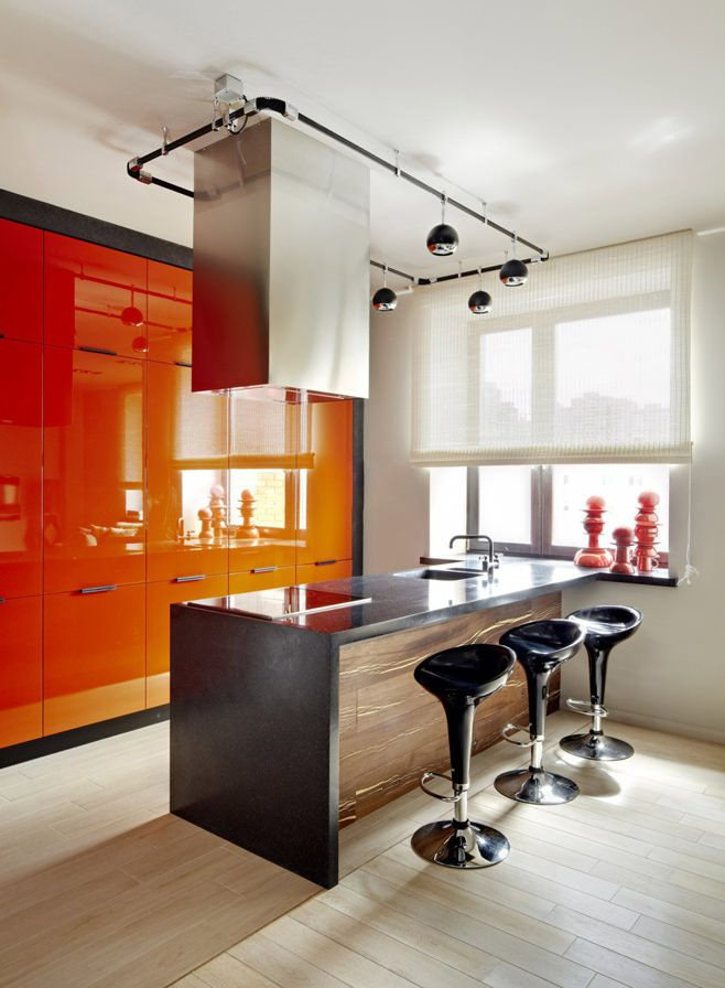 Fusion Style Kitchen Interior Design: Features and Arrangement Ideas. Marvelous glossy orange furniture and ultramodern design for small space