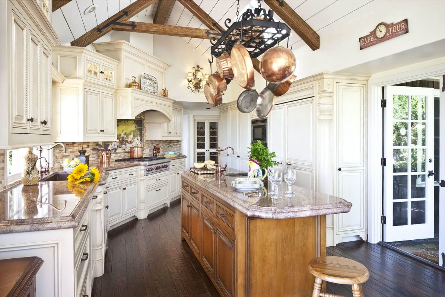 Large central wooden kitchen island in the Provence interior