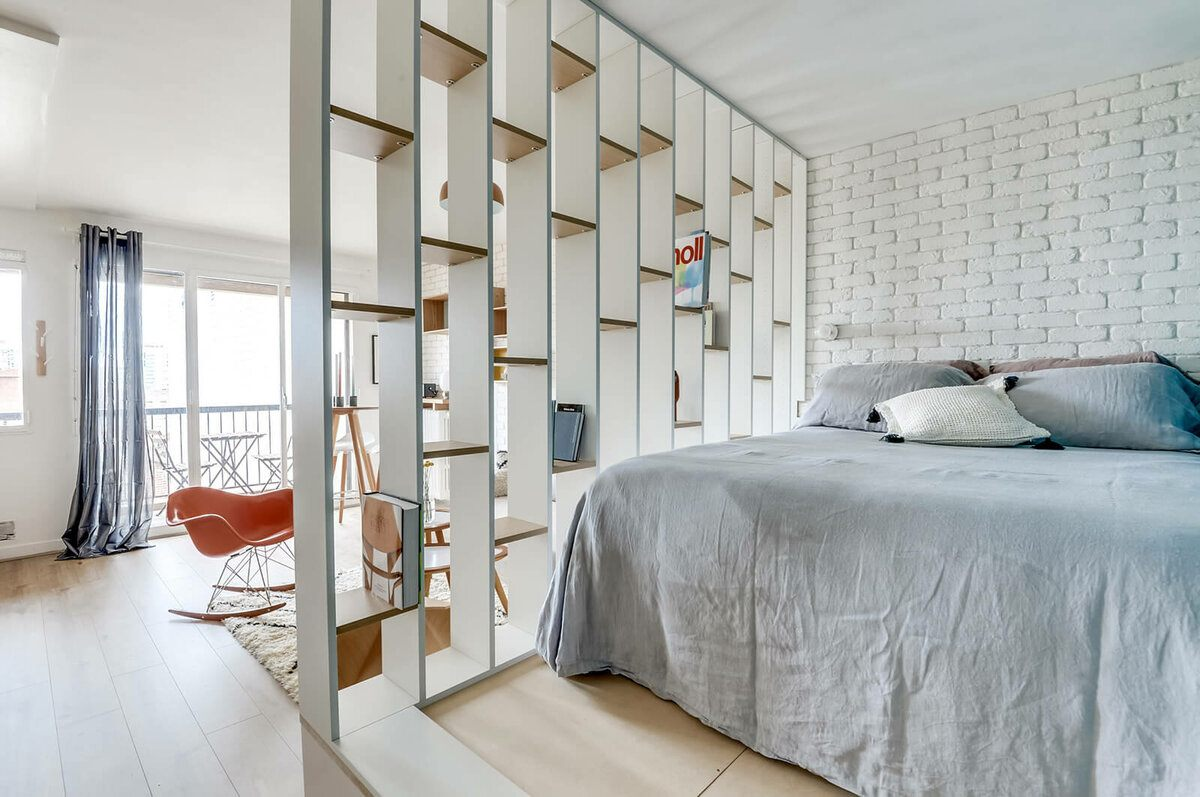 Wooden shelving to separate the bed