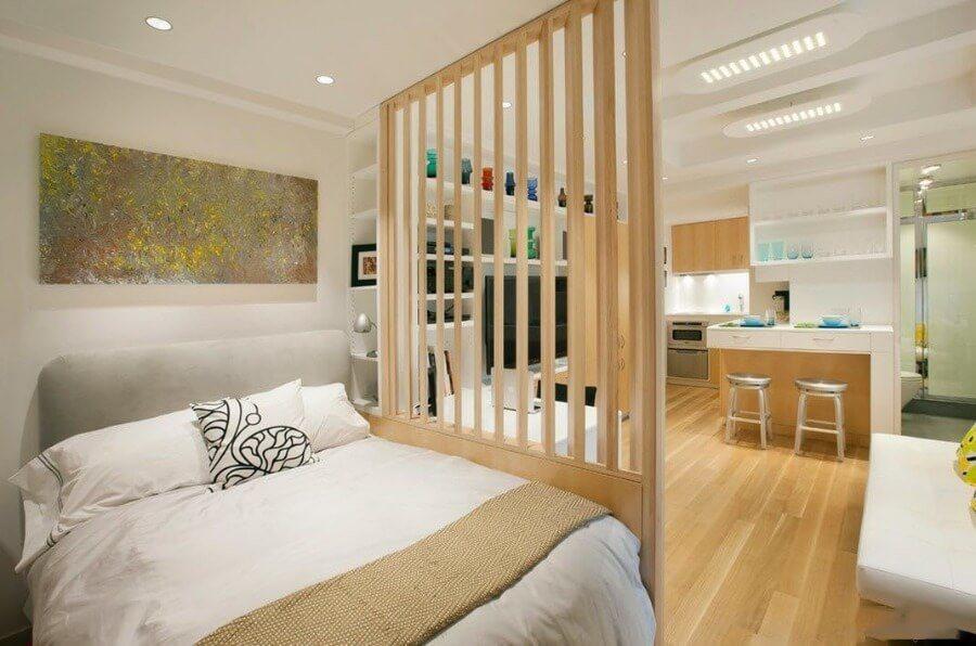 Wooden lattice separated bedroom zone in the studio